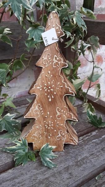 Holzbaum mit weißer Verzierung